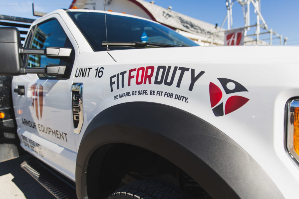 An image of an Armour Equipment truck in Calgary showing the Fit for Duty logo.