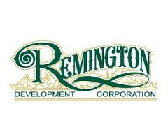 A logo of Remington Development Corporation, an Armour Equipment client.